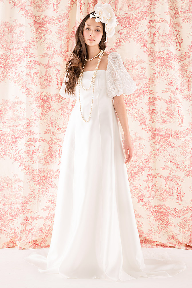 ウェディングドレス レンタル プレタ オーダー | ドレスマニア N0029 程よい透け感がエアリィさを演出、特徴的なパフスリーブも人気なウェディングドレス